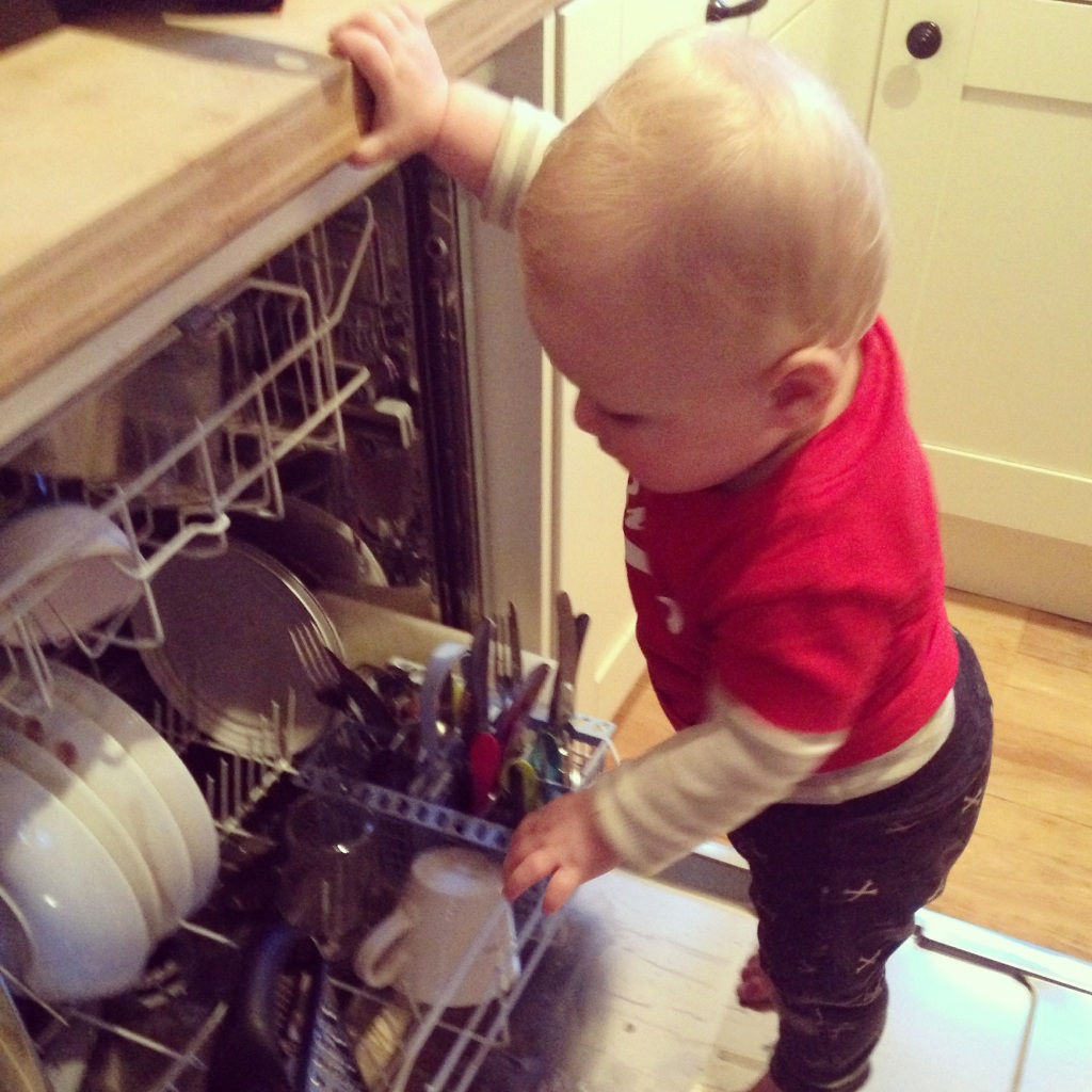 baby helping with chores