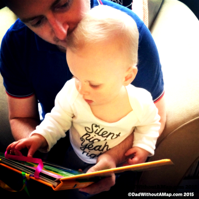Baby and dad reading book