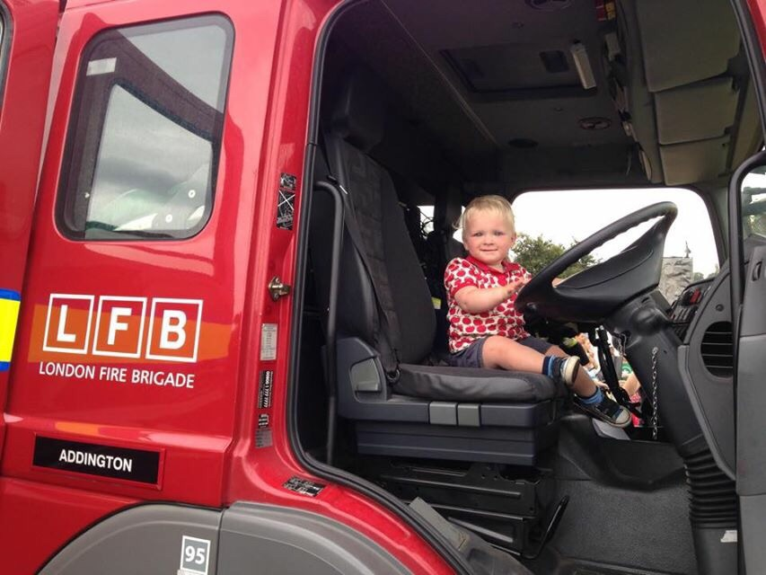 Toddler in a fire engine