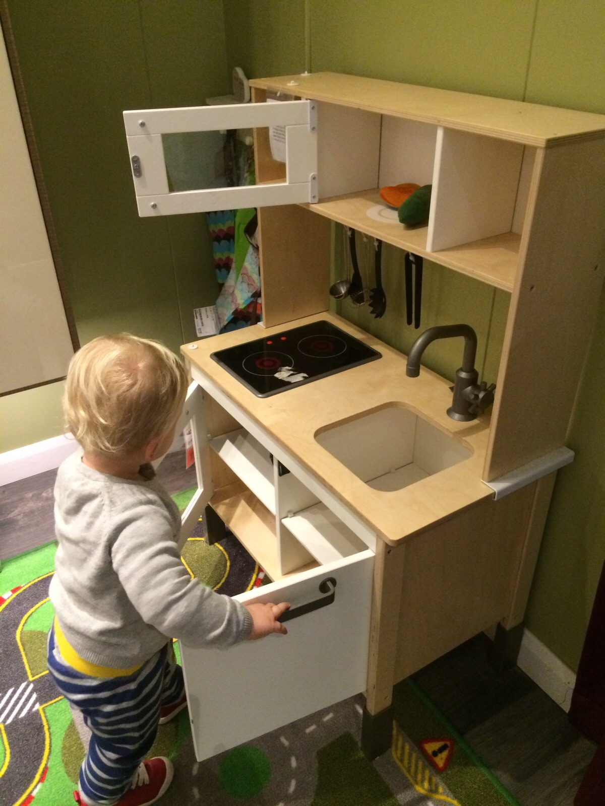 Toddler playing at cooking